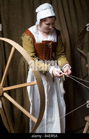 A Tudor woman spinning wool - Stock Photo