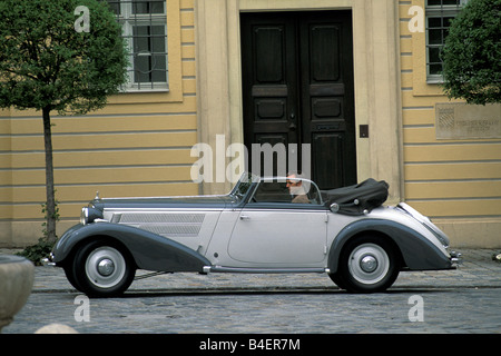 Audi 225 convertible, model year 1933-1938, grey, driving, side view, city, landscape, scenery - Stock Photo