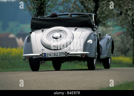 Audi 225 convertible, model year 1933-1938, grey, driving, diagonal back, back view, road, country road, landscape, - Stock Photo