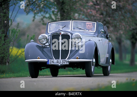 Audi 225 convertible, model year 1933-1938, grey, driving, diagonal front, front view, road, country road, landscape, - Stock Photo
