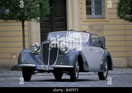 Audi 225 convertible, model year 1933-1938, grey, driving, diagonal front, front view, city, landscape, scenery - Stock Photo