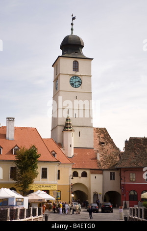Sibiu Transylvania Romania Council tower clock Turnul Sfatului and old buildings in Piata Mica in historic city - Stock Photo