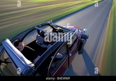 Car, Citroen 2CV Charleston, sedan, model year 1980-1989, old car, red-black, driving, road, country road, diagonal - Stock Photo