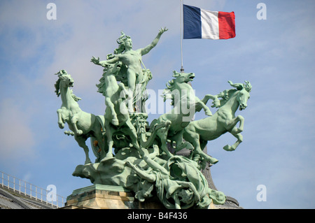 Quadriga and french Flag on the Grand Palais in paris France - Stock Photo