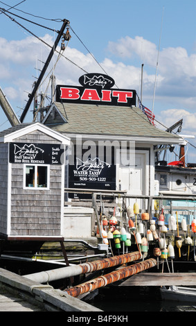 Bait shack with colorful lobster buoys in historic Plymouth Harbor, MA, New England USA - Stock Photo
