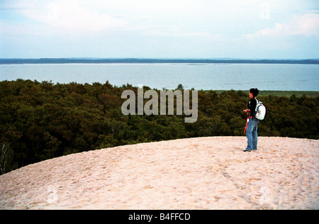 Woman on a dune in the Slowinski National Park in Leba, Poland - Stock Photo