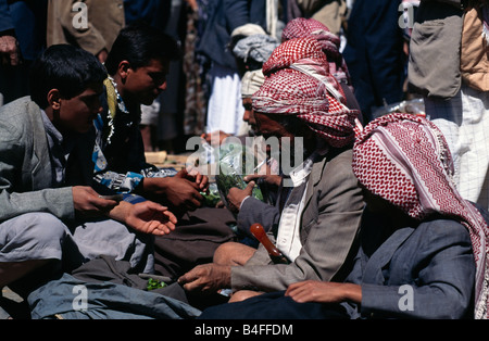 Market trader selling khat in the Old City, Sana'a, Yemen. - Stock Photo