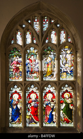 Stained glass window in the typical English country village church of All Saint's Church, All Cannings, Wiltshire, - Stock Photo