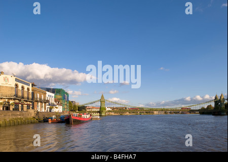 Riverside pubs and houses overlooking Thames River Hammersmith London W6 United Kingdom - Stock Photo