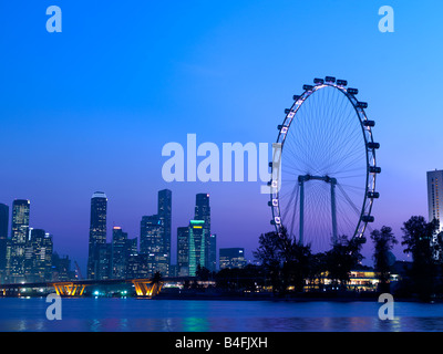 Singapore's skyline and the Singapore Flyer seen from Marina Bay. - Stock Photo