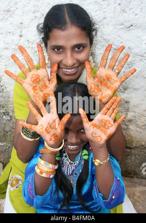 Moslem mother and daughter with Eid Mubarak henna on their hands , Eid ul Fitr celebrations , India - Stock Photo