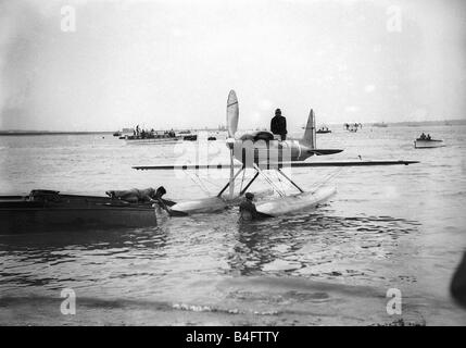 A Supermarine S6B Seaplane powered by a Rolls Royce engine seen here being towed back to shore at Calshot on the - Stock Photo