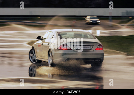 A Powerful Mercedes car on a skid pan at Mercedes Benz World in Surrey, UK - Stock Photo