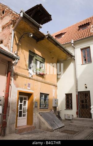 Sibiu Transylvania Romania Europe Old building in small street in historic city centre - Stock Photo