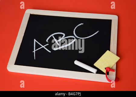 A chalkboard with 'ABC' written on it - Stock Photo