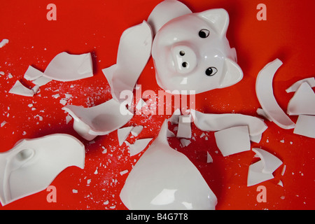 A smashed empty piggy bank - Stock Photo