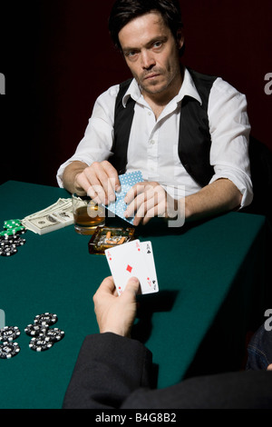Two men playing poker at a high stakes game - Stock Photo