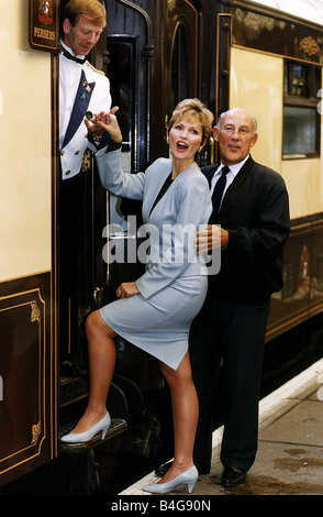 Stirling Moss Former Racing Driver with Actress Fiona Fullerton launch The Orient Express Trophy from Victoria Station - Stock Photo
