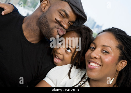 Two parents and their son goofing around - Stock Photo
