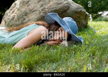 A girl lying in grass - Stock Photo