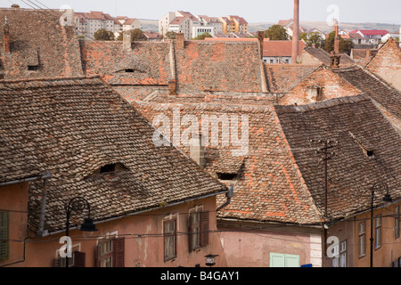 Sibiu Transylvania Romania Europe High view of old buildings and tiled rooftops in historic city centre - Stock Photo