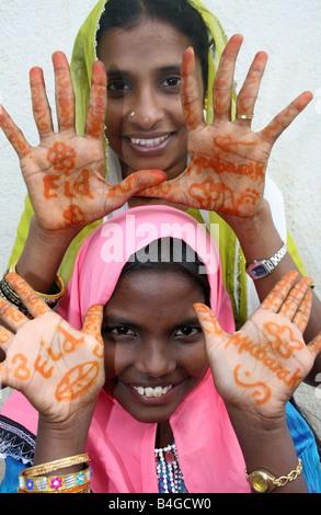 Moslem woman and child with Eid Mubarak henna on their hands , Eid ul Fitr celebrations , India - Stock Photo