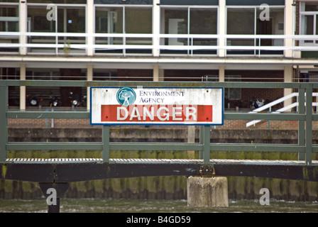 british environment agency danger sign at teddington lock on the river thames, southwest london, england - Stock Photo