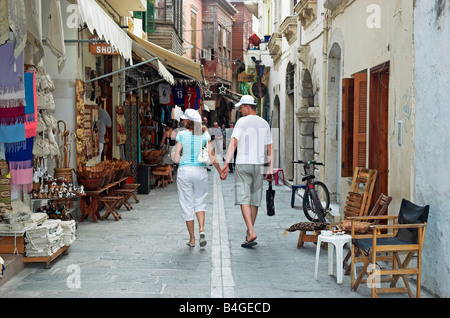 Tourists walking narrow streets of Old Town Rethymno Crete island Greece September 2008 - Stock Photo