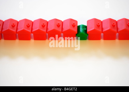 Row of monopoly hotels and green house - Stock Photo