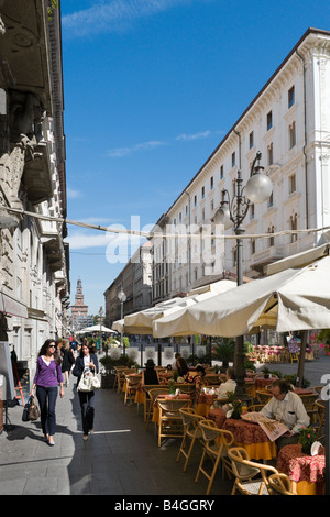 Cafe on the Via Dante at breakfast time looking towards the Castello Sforzesco, Milan, Lombardy, Italy - Stock Photo