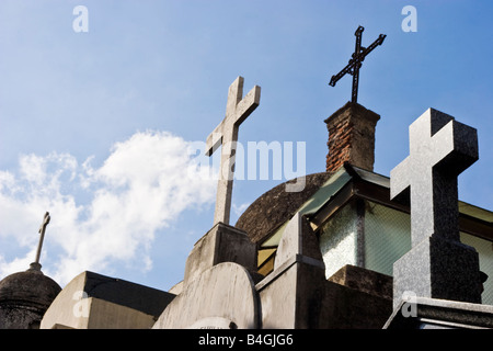Crucifixes on top of a row of tombs in Recoleta Cemetary - Stock Photo
