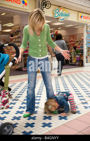 little girl having a tantrum in a shopping centre - Stock Photo