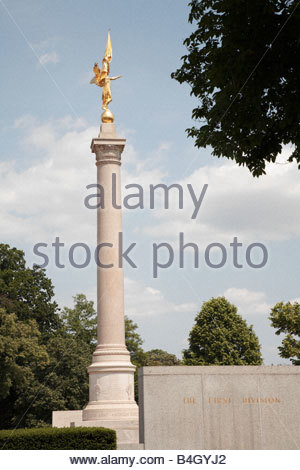The gold Winged Victory atop a column at the First Division Monument in Washington, DC. - Stock Photo