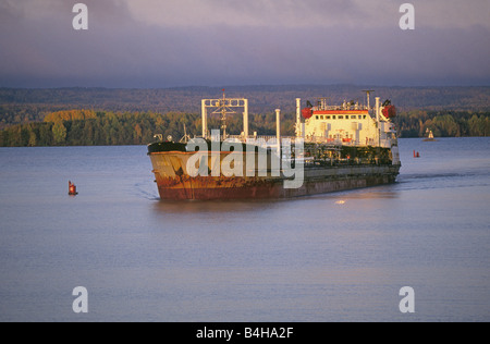 Modern day Volga Boatmen operate a small fuel tanker ship sails upriver on the Volga River between Moscow and St - Stock Photo