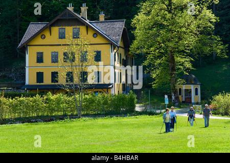 Senior couples walking in field Jagdschloss Offensee Ebensee Salzkammergut Austria - Stock Photo