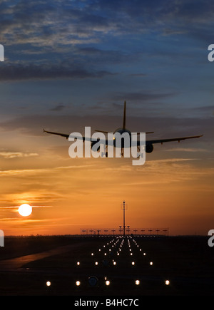Airplane taking off from runway at dusk - Stock Photo