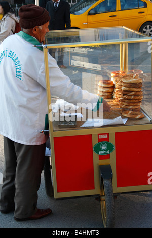 food seller selling simit turkish bagel grand bazaar. Black Bedroom Furniture Sets. Home Design Ideas