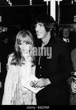 Peter Cook comedian actor and wife Judy Huxtable 1970 arrive at premiere film The Rise and Rise of Michael Rimmer - Stock Photo