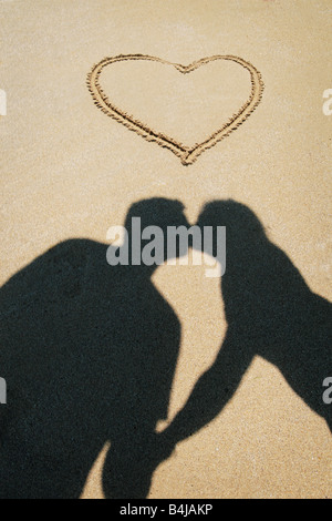 couple kissing on the beach - Stock Photo