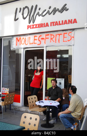 restaurant offering mussels during Lille Braderie France - Stock Photo