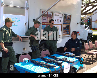 Members of the Redondo Beach police dept swat team chat during safety fair - Stock Photo