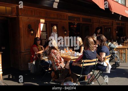 Al fresco dining at the sidewalk cafe of Morandi restaurant in New York in the Greenwich Village neighborhood - Stock Photo