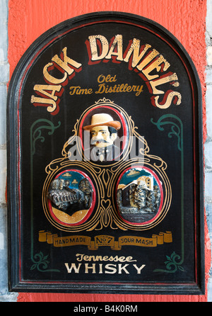 Old advertisement for Jack Daniels Bourbon Whisky on the wall of a hotel bar - Stock Photo