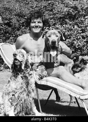 Jess Conrad singer and actor in his garden with two of his unwanted dogs that he has collected Blue a Fourteen month - Stock Photo