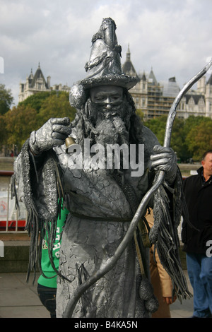 Street entertainer dressed as a statue on the south bank of the River Thames near Waterloo London - Stock Photo