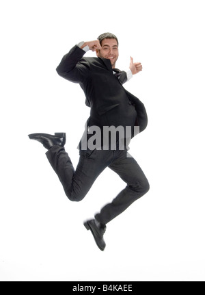 businessman leaps in air - Stock Photo