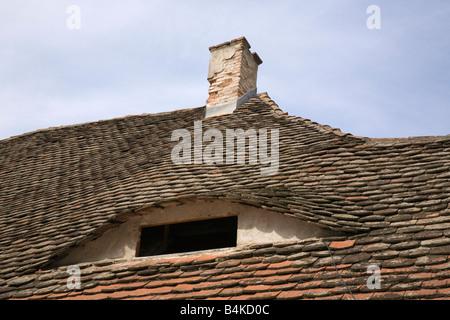 Sibiu Transylvania Romania Europe Eyes of Sibiu on tiled roof of old historic building with eye window - Stock Photo