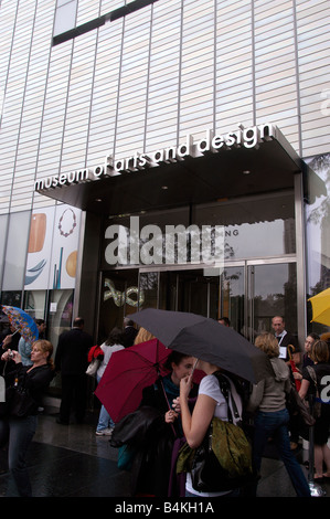 Attendees to the opening weekend of he Museum of Arts and Design in Columbus Circle in New York - Stock Photo