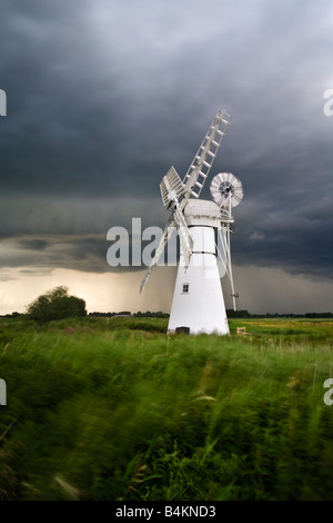 The white painted structure of Thurne Mill during a storm on the Norfolk Broads - Stock Photo
