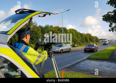 British traffic policeman operating a laser speed camera - Stock Photo